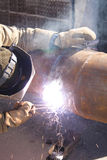 Welding. Welder welds pipe Stock Images