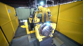 Welding Automation Timelapse. Yellow robot weld metal structure 4K stock video