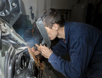 Welding car. Welding the car body after the accident Stock Photo