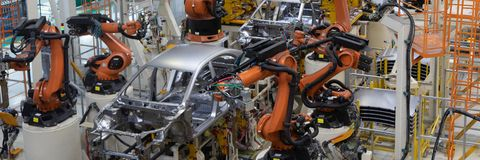Welding of car body. Automotive production line. long format. Wide frame. Assembly line production of new car. Automated welding of car body on production line royalty free stock image