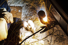 Welding car turnbuckle in snow field at night Stock Photography