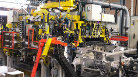 Welding the chassis of a car. Welding the chassis of a car in a modern factory Stock Image