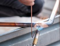 Welding of copper pipe. Welding of copper pipe of a methane gas pipeline or of a conditioning or water system royalty free stock photo