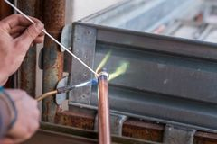 Welding of copper pipe. Welding of copper pipe of a methane gas pipeline or of a conditioning or water system stock photos