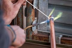 Welding of copper pipe. Welding of copper pipe of a methane gas pipeline or of a conditioning or water system royalty free stock photos