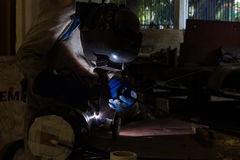 Welding in the dark Stock Image