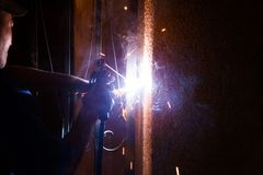 Welding Electricity. Worker welding electricity iron with many sharp sparks Royalty Free Stock Images