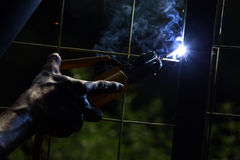 Welding Electricity. Worker welding electricity iron with many sharp sparks Stock Images