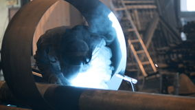 Welding Engineer weld for the creation of pipes.a stock footage