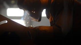 Welding Engineer weld metal. bright sparks, smoke stock footage