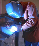 Welding Fabrication. Welder fabricating a motorcycle stand Royalty Free Stock Images