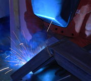 Welding Fabrication. Welder fabricating a motorcycle stand Royalty Free Stock Photography