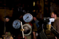 Welding gas cylinder pressure gauge close up in forge Royalty Free Stock Images