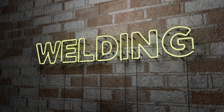 WELDING - Glowing Neon Sign on stonework wall - 3D rendered royalty free stock illustration Stock Photography