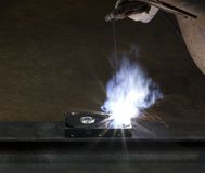 Welding on a hard drive Stock Photo