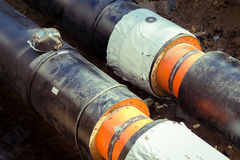 The welding helmet on the heat pipeline Royalty Free Stock Image