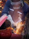 Welding at industrial factory. Industrial worker at the factory welding closeup Stock Images