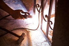 Welding iron. Worker welding electricity iron with many sharp sparks Royalty Free Stock Photo