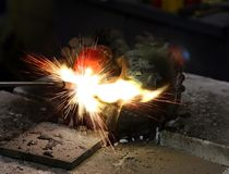 Welding job. In repair facility Stock Photos