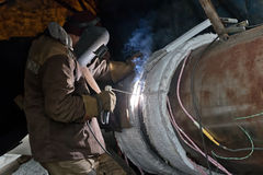 Welding large diameter pipes with pre-heated flexible ceramic heating elements Stock Photo