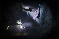 Welding in low light area Stock Photo