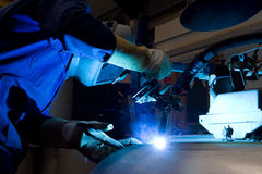 Welding machine operator Stock Images