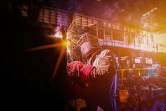 Welding man. Industrial Worker at the factory pipe welding dark tone Royalty Free Stock Photo