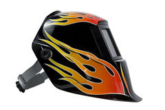 Welding Mask. A modern, black, auto-darkening welding mask with flame art decoration royalty free stock photography