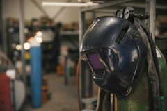 Welding mask in workshop. Close up Royalty Free Stock Images