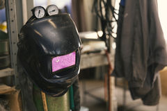 Welding mask in workshop Stock Photo