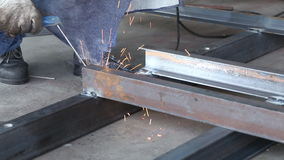 Welding metal bar by worker stock video