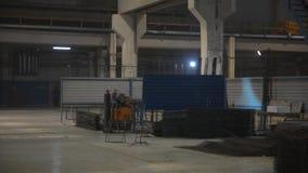 Welding of metal fittings in the workshop stock video footage
