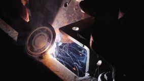 Welding In Metal Industry. Flashes and lot of sparks from welding work at construction site in dark. Welding in metal industry. Close-up view of a welding stock video