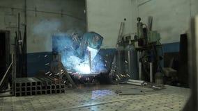 Welding metal parts stock video footage