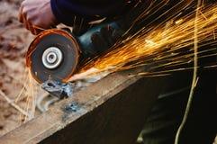 Welding metal, sparks spreading. Worker grinding/welding metal and sparks spreading Royalty Free Stock Image