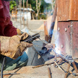 Welding metal and wood by electrode with bright electric arc Stock Photo