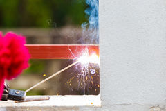 Welding metal and wood by electrode with bright electric arc Royalty Free Stock Photos