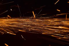 Welding Metallic Structure with Flames Background Photograph. Welding a metallic structure around a construction site with dark black background unique stock Stock Photo