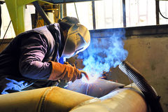 Welding with mig mag method. Inside of factory Stock Photo