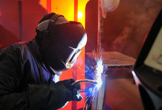 Welding with mig-mag method. Working in plant Royalty Free Stock Photography