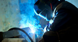 Welding with mig-mag method. Shoot inside of factory Stock Photo