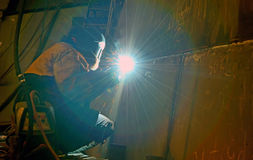 Welding with mig-mag method. Inside of shipyard Stock Images