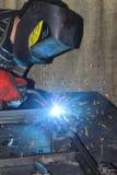 Welding operator. The welder in work process royalty free stock photo