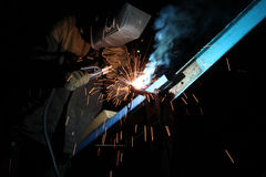 Welding operator welds metal constructions Stock Image