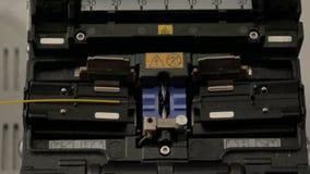 Welding of optical fiber welding machine. Internet communications link stock photos