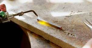 Welding piece of metal in workshop 4k stock video