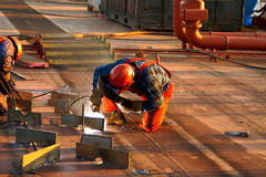 Welding plates on a tanker. Welders working on plates on the main deck of a tanker Royalty Free Stock Photos