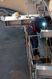 Welding and repair. Worker to work in the yard, a strong beam of a steel structure Stock Image