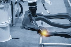 The welding robot machine for welding automotive part. The welding robot machine for welding automotive part in the light blue scene.Industrial 4.0 concept for royalty free stock image