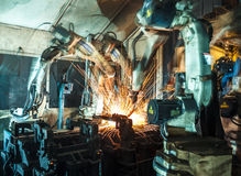 Welding Robot movement in a car factory Royalty Free Stock Images
